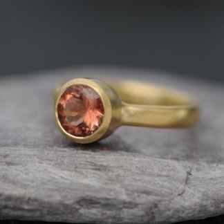oregon sunstone solitaire set in simple gold ring design