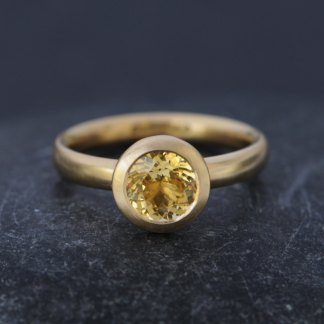 18K Gold ring with yellow sapphire solitaire stone. A contemporary design