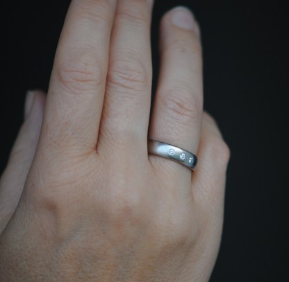 18K white gold band with 3 diamonds on hand