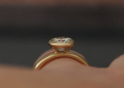 1.25ct moissanite halo ring in 18K y gold