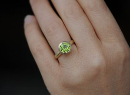 peridot 8mm halo ring in 18K y gold
