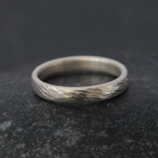 textured silver wedding band for her.