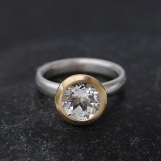 white topaz halo ring in 18K y gold and silver band