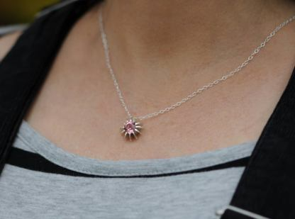 sea urchin necklace on neck