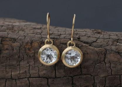 white topaz drop earrings in 18K yellow gold