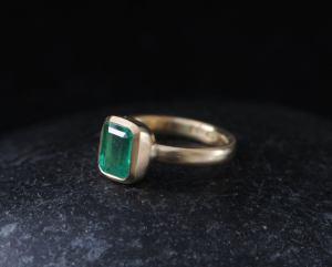Emerald cut emerald ring in 18K yellow gold