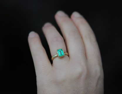 Emerald cut emerald ring in 18K yellow gold