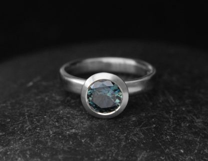 teal 7mm sapphire halo ring 18K white gold