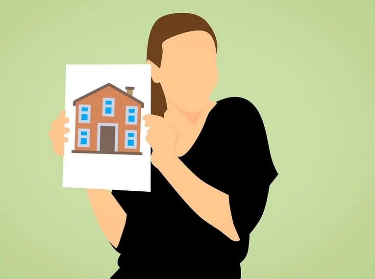 holding a picture of a house