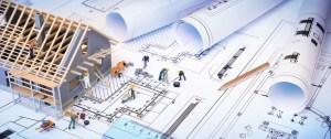 house under construction on blueprints – building project