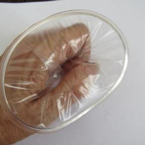 Female Condom from the USA in the hand to show how it appears from the vagina
