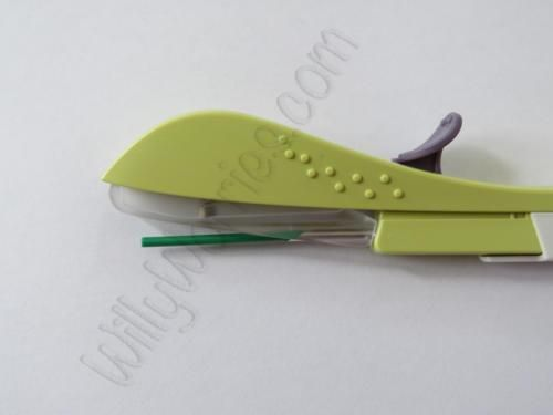 The insertion device 'drops' the implant in to place when the purple coloured lever on the top is fully drawn back to base after the insertion procedure takes place. This is a safety device, to protect the inserter from accidental needlestick injury.