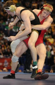 When Cornell's Kyle Dake (right) defeated Iowa's Derek St. John for the 2012 NCAA championship last March, it marked the Big Red wrestler's third title at three different weights in three straight years.