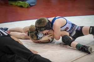 Caiden Hart (right) of Ohio lost a first-round match, but came back to win three consolation bouts and finish sixth at 62 pounds in Division 3 of the 2013 NUWAY Nationals in Battle Creek, Mich.