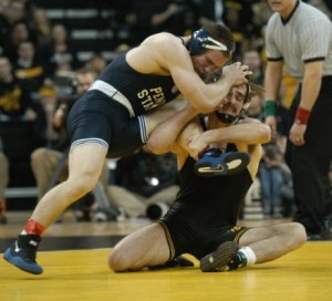 Iowa's Mike Evans (right) was nearly taken down before he corrected his base and eventually defeated Penn State's Matt Brown in their 174-pound bout in Iowa City on Feb. 1.