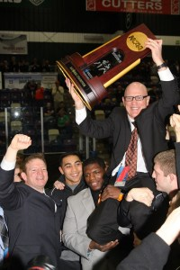 Wartburg coach Jim Miller was all smiles as he hoisted the 2013 NCAA Division III team trophy after the 59-year-old coach was hoisted on the shoulders of his final Wartburg team.