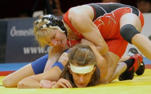 Alyssa Lampe (top) only needed 46 seconds to pin Melanie LeSaffre of France at 48 kilos.
