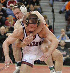 In a battle between former NCAA champions, Oklahoma State's Chris Perry (top) avenged an earlier-season loss to Oklahoma's Andrew Howe in the Big 12 championship bout.