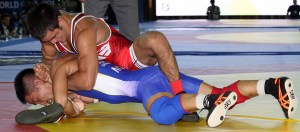 In just his first World Championships, Tony Ramos (top) wrestled in just one match at 57 kilos. (Bob Mayeri image)
