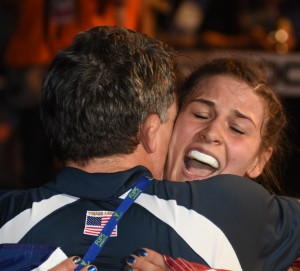 Adeline Gray hugged her coach Terry Steiner after capturing a third World championship in six World tournaments. (Ginger Robinson photo)