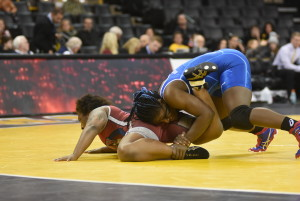 Tamyra Mensah (right) controlled 2008 Olympic bronze medalist Randi Miller and won both bouts at 152 pounds in the Special Wrestle-off in Iowa City. (Ginger Robinson photo)