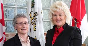 Carmen Krogh (L) receiving the Queen Elizabeth II Diamond Jubilee Medal from MP Cheryl Gallant