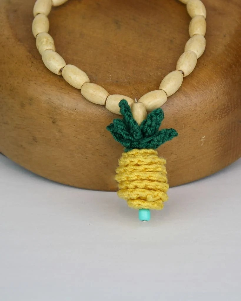 Crochet a quick and easy Pineapple Pendant or two and wear them on a necklace, bracelet, earrings or even as a zipper pull. This free crochet pattern takes very little time to accomplish with just a few basic jewelry and crochet supplies. This is a great project using only basic crochet stitches. Photo tutorial is available for any slightly tricky parts so even beginners can make this project. #forbeginners #quick #easy #crochet #freecrochetpattern #freecrochet #crochetpattern #pineapple #jewelry #crochetjewelry #crochetnecklace #crochetearrings #crochetbracelet #earrings #pineapplejewelry
