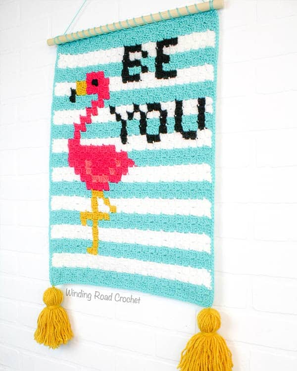 Find your Flock: Be You Flamingo Wallhanging is a fun corner to corner crochet project that will inspire you everytime you look at it. The C2C graph and written pattern are included. Plus tips and instructions for making your wallhanging look finished. Free crochet pattern. #freepattern #flamingo #crochet #C2C #cornertocorner #wallhanging