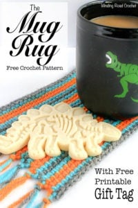 The mug rug is a perfect stocking stuffer next to the cup cozy! But what is a mug rug? It is an oversized coaster big enough for a Mug and a snack! Cookie anyone? This free crochet pattern is quick, easy and great for beginners. Plus if you sign up for my newsletter you get a free printable gift tag to make gifting it that much easier! #mugrug #crochet #free pattern.
