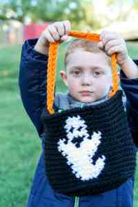 Candy bucket Free Crochet Pattern | Halloween always sneaks up on me, so I need my Halloween crochet projects to be quick and easy. This pattern is great for beginners with an optional trim. There are three charts to add extra character to your candy bucket. #halloween #crochet # crochetpattern #holidaydecor