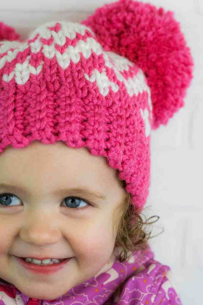 Use the knit stitch or waistcoat stitch to make this double pom pom crochet hat pattern. Video tutorial included to show you how to crochet this stitch.