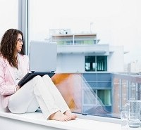lady sitting in a window