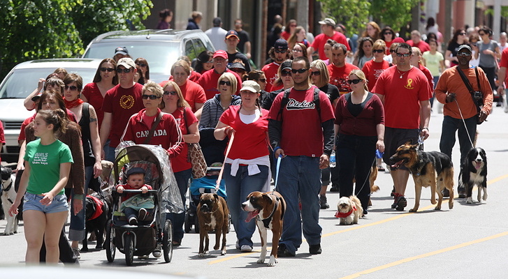 A large group of local residents participate in a rally against animal abuse May 15, 2010, in Windsor, ON. Here they march with their pets along Ouellete Ave.