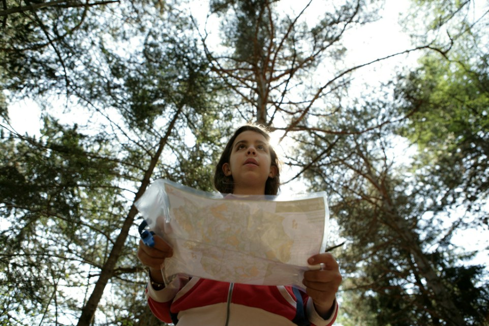 Girl holding a map and orienteering