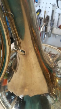 Unsoldered tip of brace on French Horn