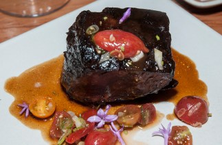 Schmitz Ranch beef short rib, white grits, fennel-tomato relish Silverado strawberries.