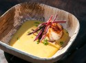 Pan-seared scallop in Saffron Bisque.