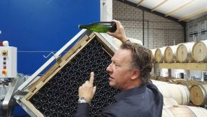 Karel Henckens of Wijndomein Aldeneyck, Maasvallei, Belgium, showing the lees in his delicious Pinot Brut. September 2016.