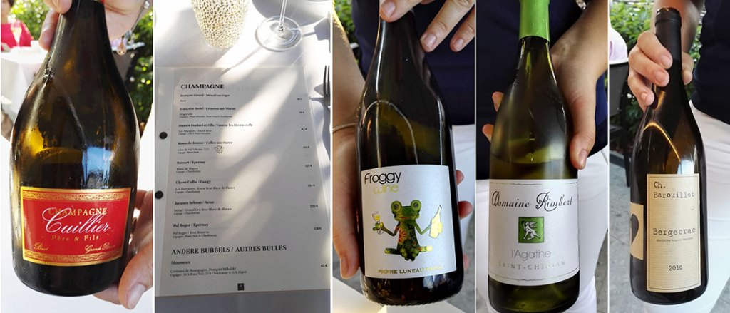 The Sommelier's Suggestions Wine List at Restaurant L'Envie, flanked by a few of the wines from the matching wine package