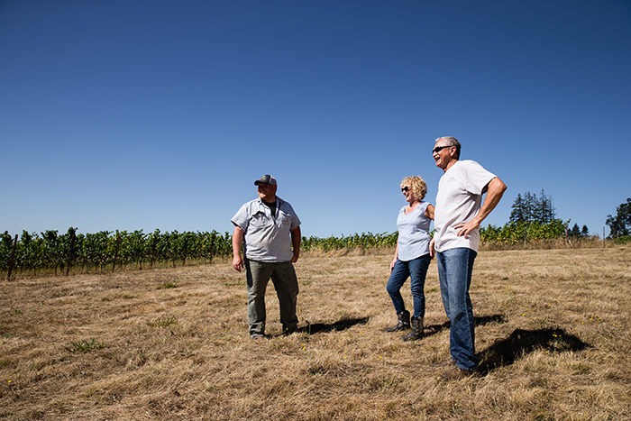 Left to right: Dustin Dusschee, Helen Dusschee and Dan Dusschee, at Freedom Hill Vineyard / Photo by Chris Low