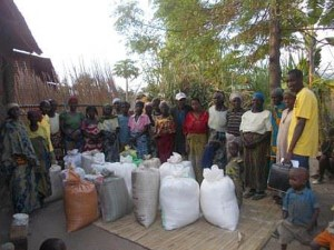 People gathered around bags of rice