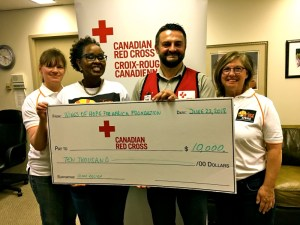 Awarding of a $10,000 cheque to the Canadian Red Cross