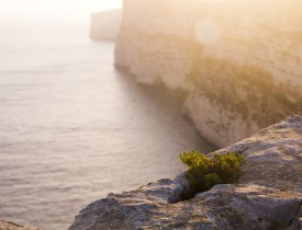 Malta_cliffs_sunset_flare