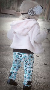 Baby Girl modeling my make of Bella Sunshine Designs' bow tie leggings