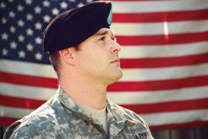 Veteran in front of flag