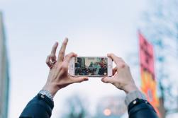 Hands holding phone to take photo