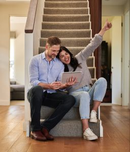Couple celebrating on stairs