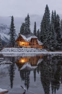 Home in winter on lake
