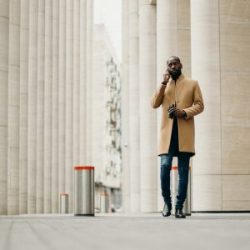 Business man walking and talking on phone