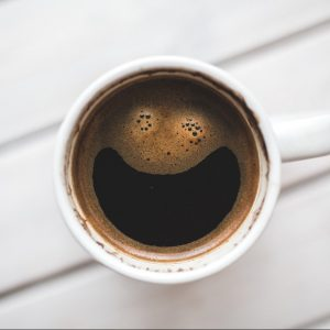 Happy face in coffee mug